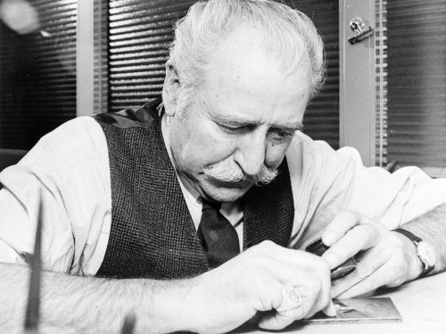 black and white image of bank note engraver George Gundersen at work
