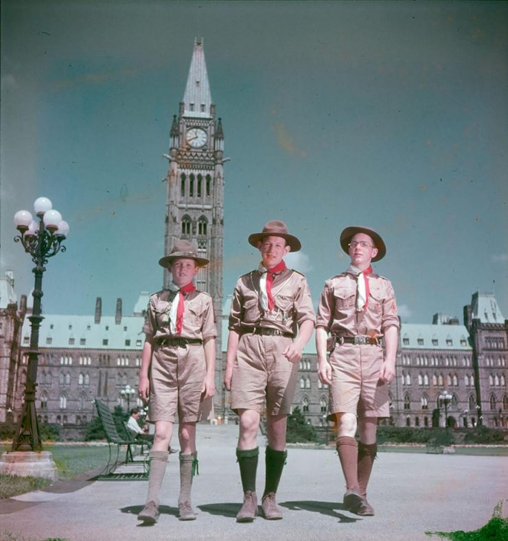 early colour photo, 3 boy scouts in front of Parliament