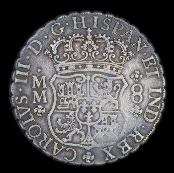 old coin with Spanish coat of arms