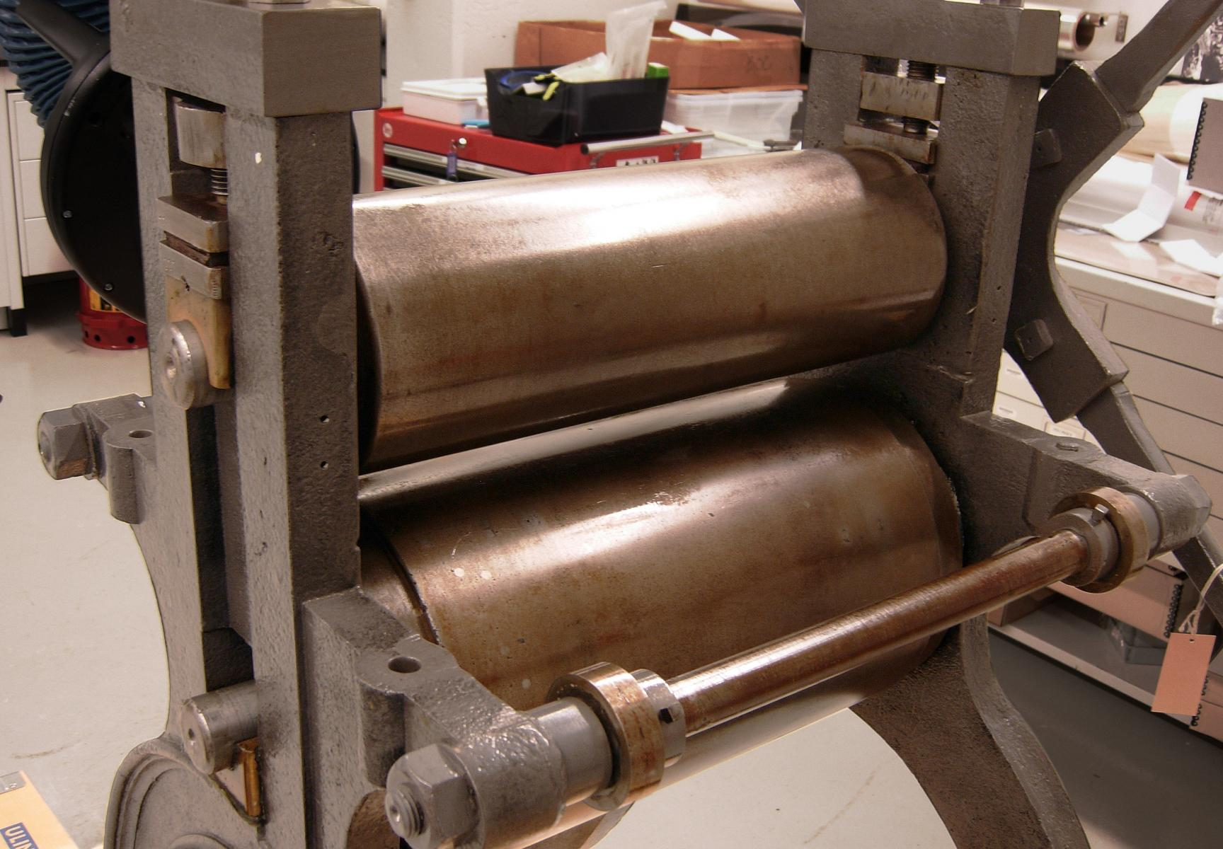 19th century print press showing oiled cylinders