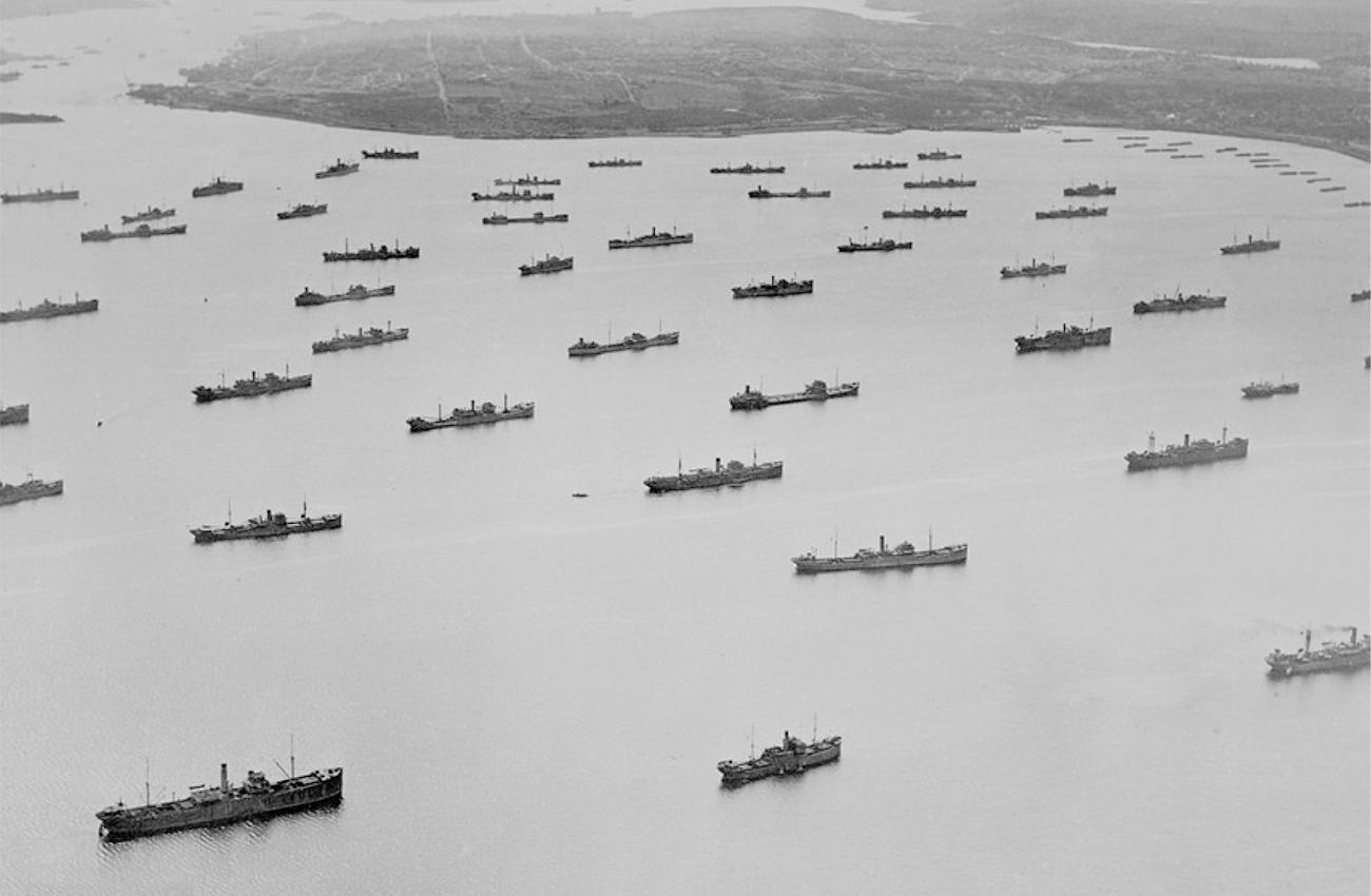 black and white photo of cargo ships in harbour