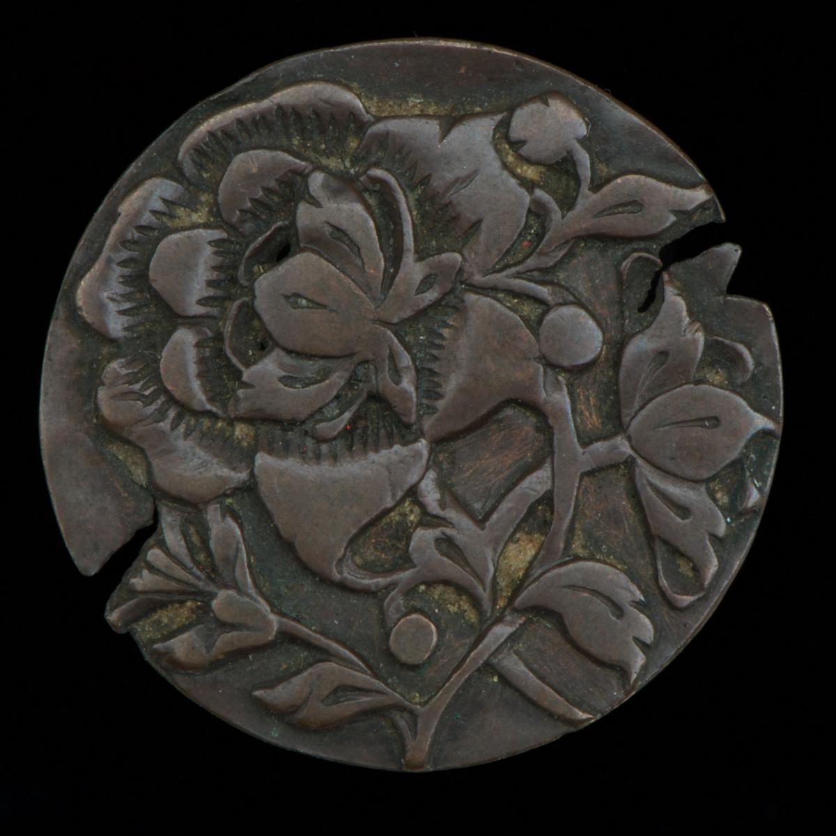 Hand engraved token with floral pattern