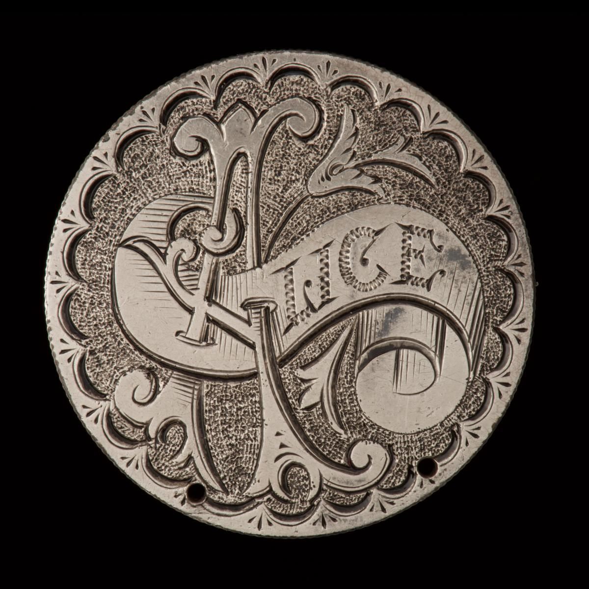 "Hand engraved token with ""Alice"""