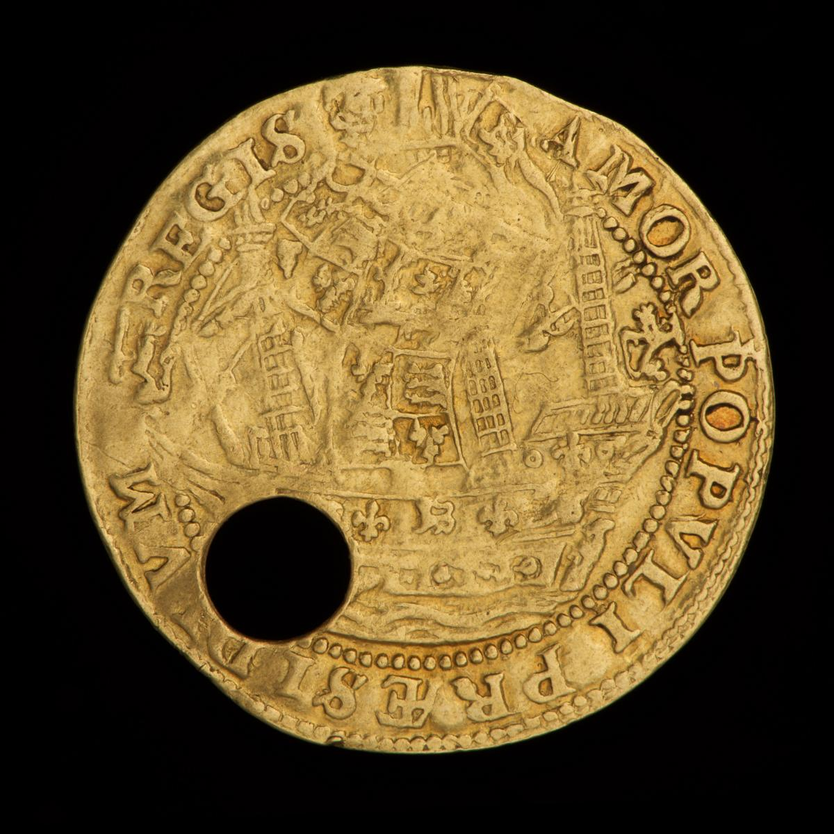 Back of a pierced gold coin with a ship