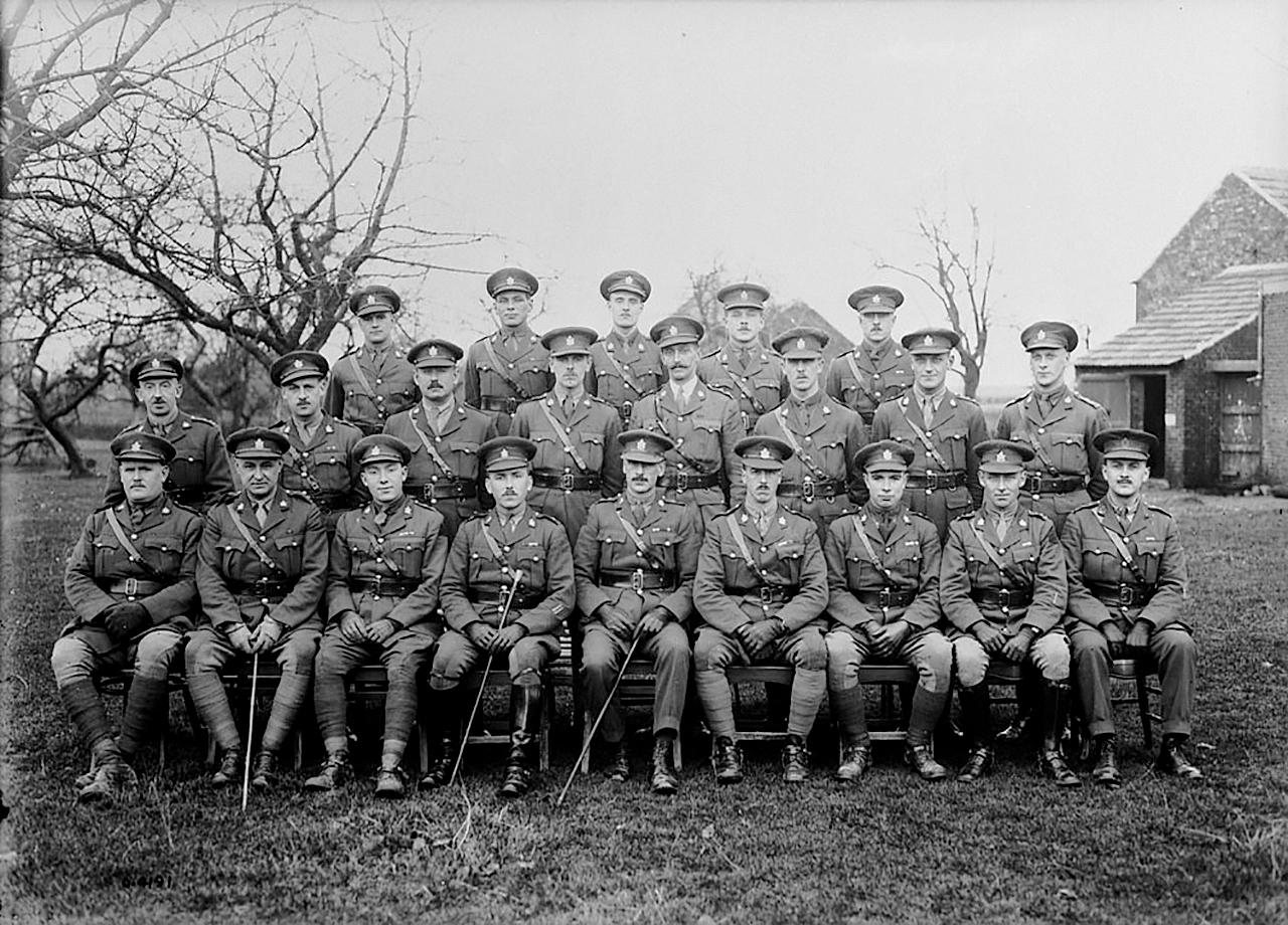 twenty-one Canadian First World War officers pose in rows on a farm