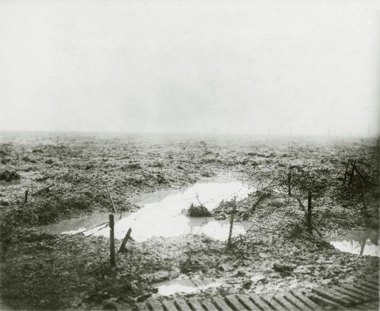 black and white picture of battlefield of mud and water