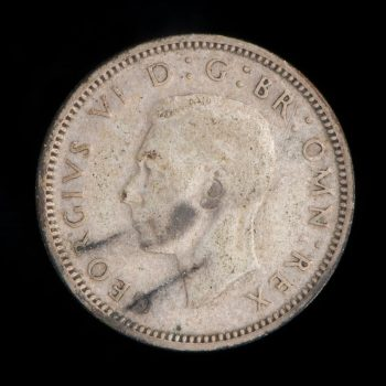 Old coin with image of King George VI