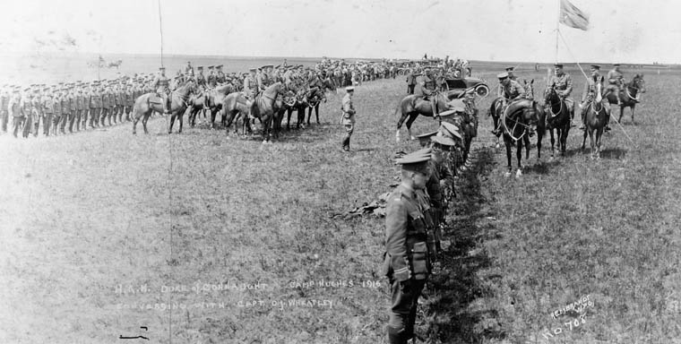 black and white photo showing rows of soldiers on the prairies