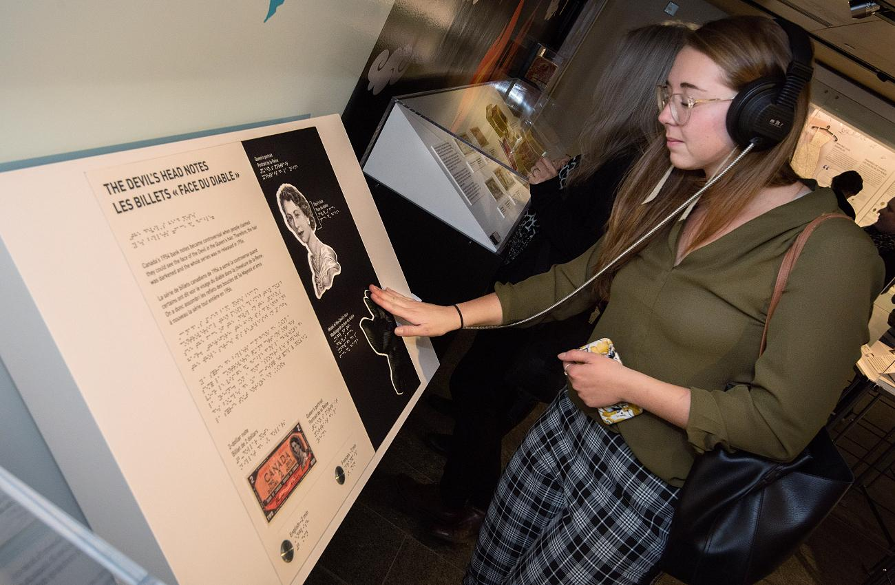 woman touching an exhibition element