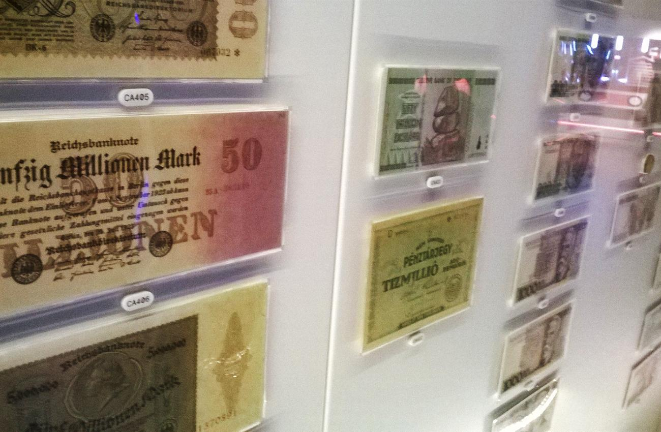 bank notes in a museum case