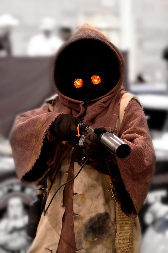 "a person in a homemade <i>Star Wars</i> ""Jawa"" costume"