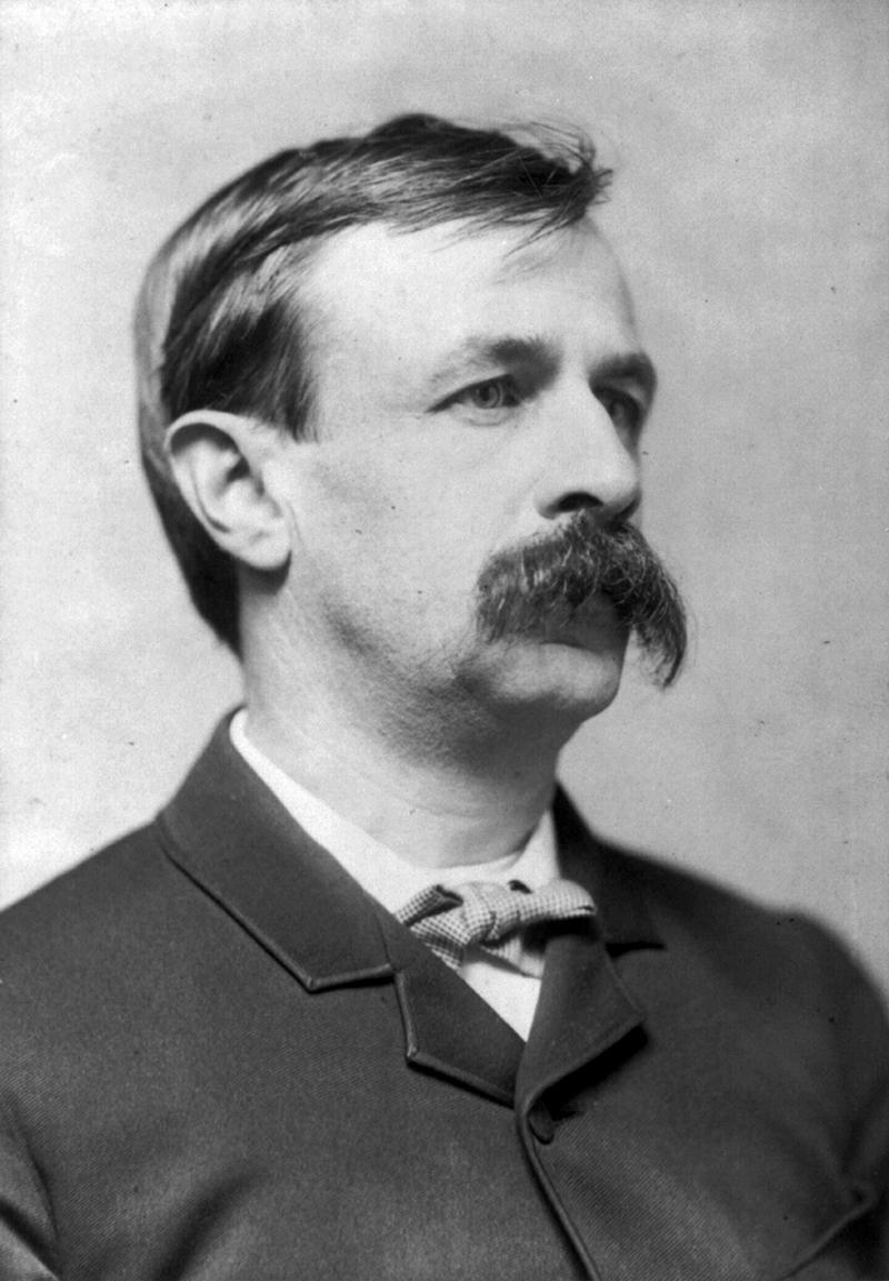 black and white photo of man with big mustache