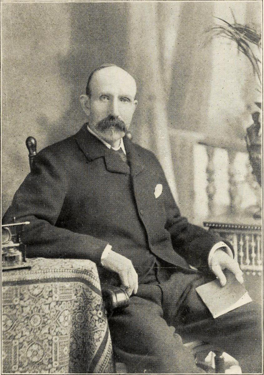 black and white photo of man with big mustache and 19th century clothes