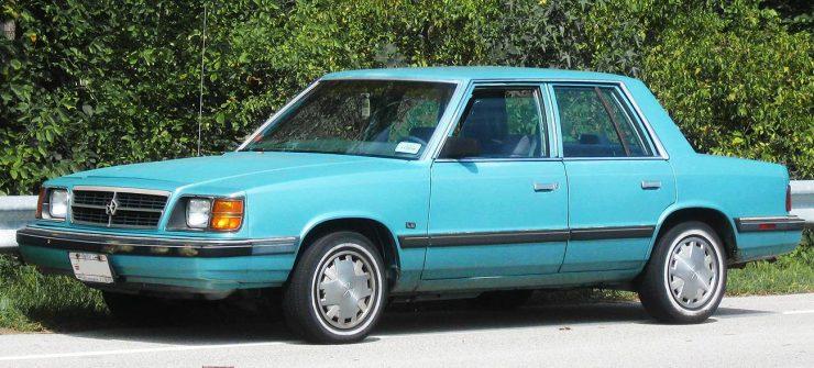 A plain, compact, four-door sedan.