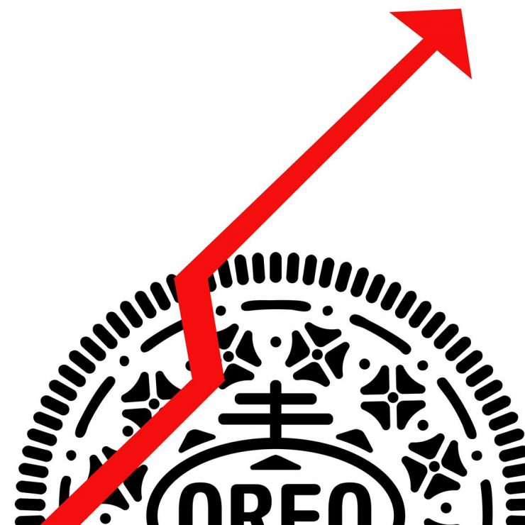 Illustration of a cookie and a rising arrow on a graph.
