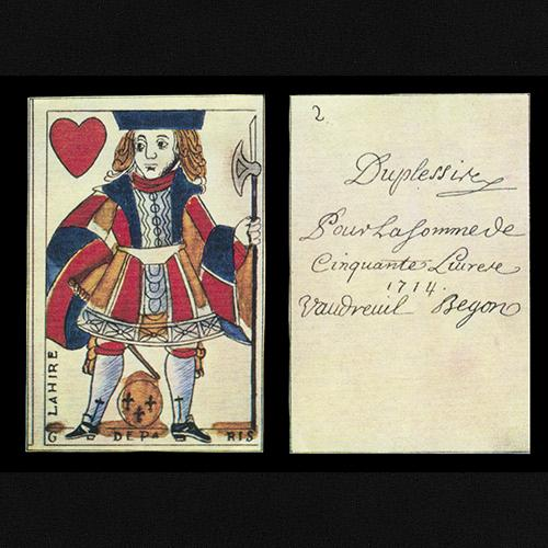 Playing card money showing a nobleman in the suit of hearts. On the back, text dated 1714 describing a sum of money to be paid back.