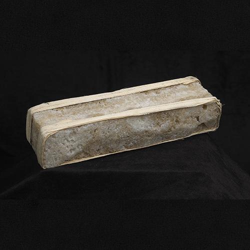 Long, light brown rectangular brick of salt.
