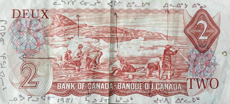 $2 bill featuring Inuit hunting scene with each hunter labelled in Inuktitut.