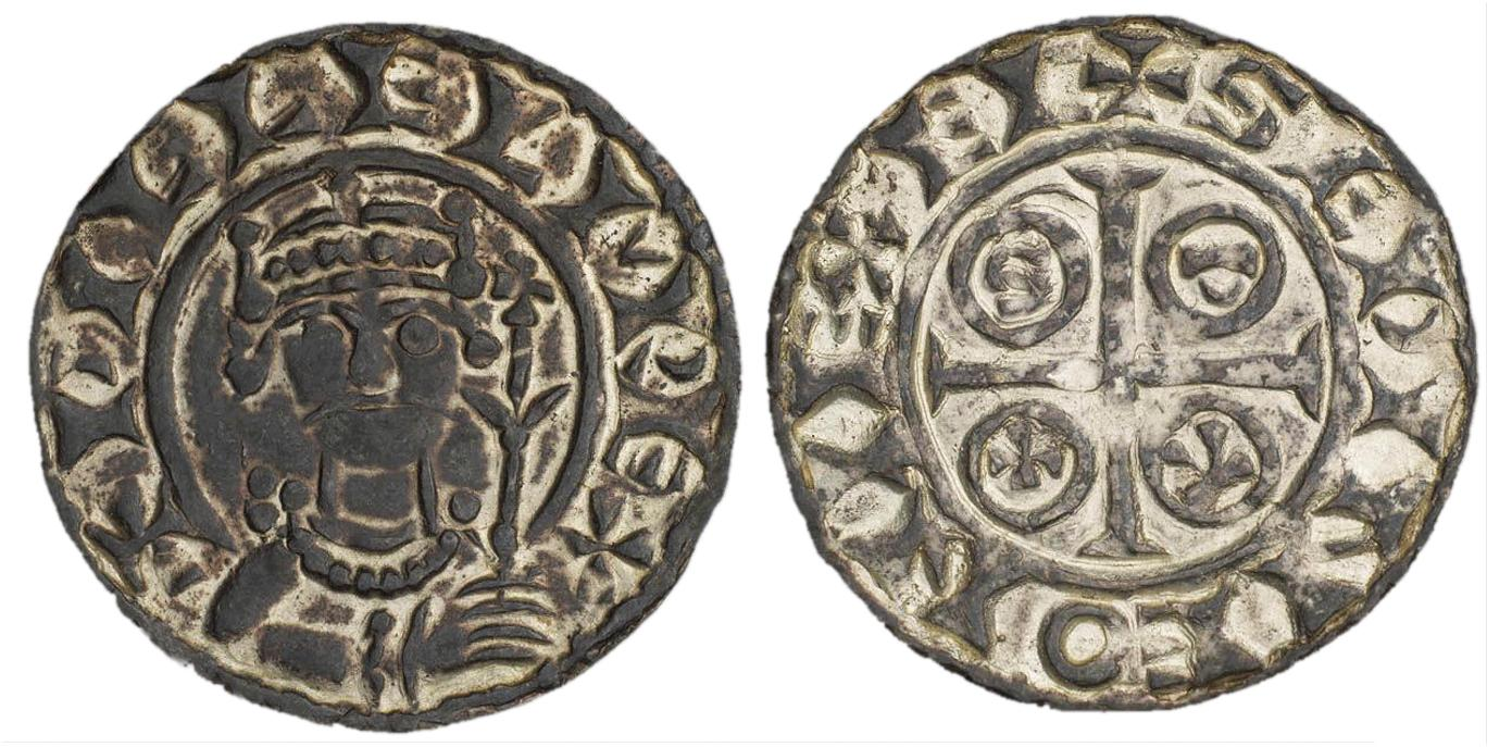 A coin with an image of a king wearing a moustache and holding a sceptre.
