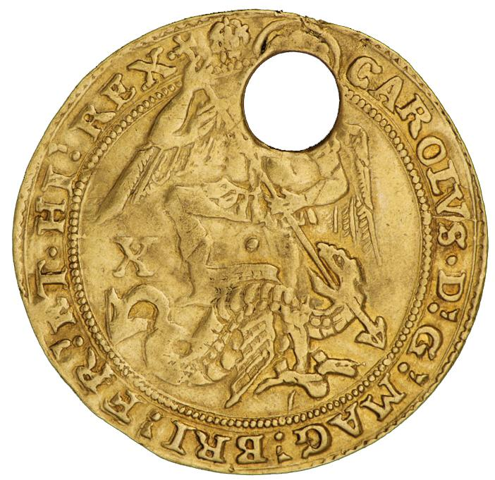 A pierced, gold coin with a warrior angel killing a dragon.