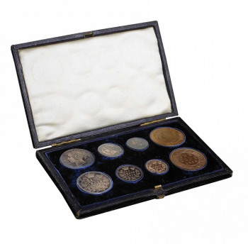 Set of eight coins in a velvet-lined box.