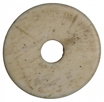 Disc, dull yellowish white, with hole in centre.