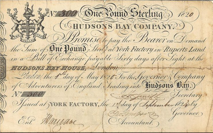 Bank note, yellowed, many lines of flowing scripted words and coat of arms bounded by moose.