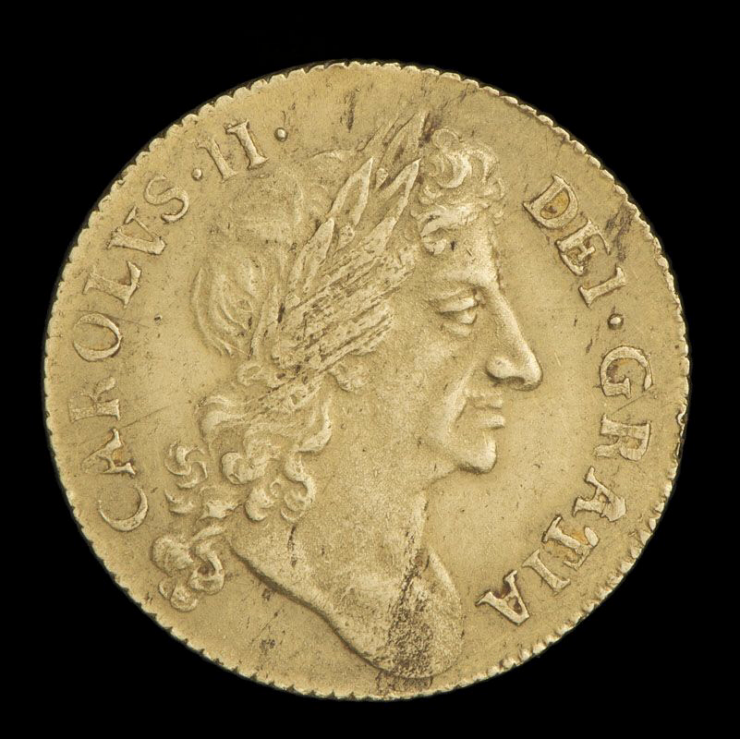 Coin, gold, Latin text around the edges, a man's head in profile facing right.