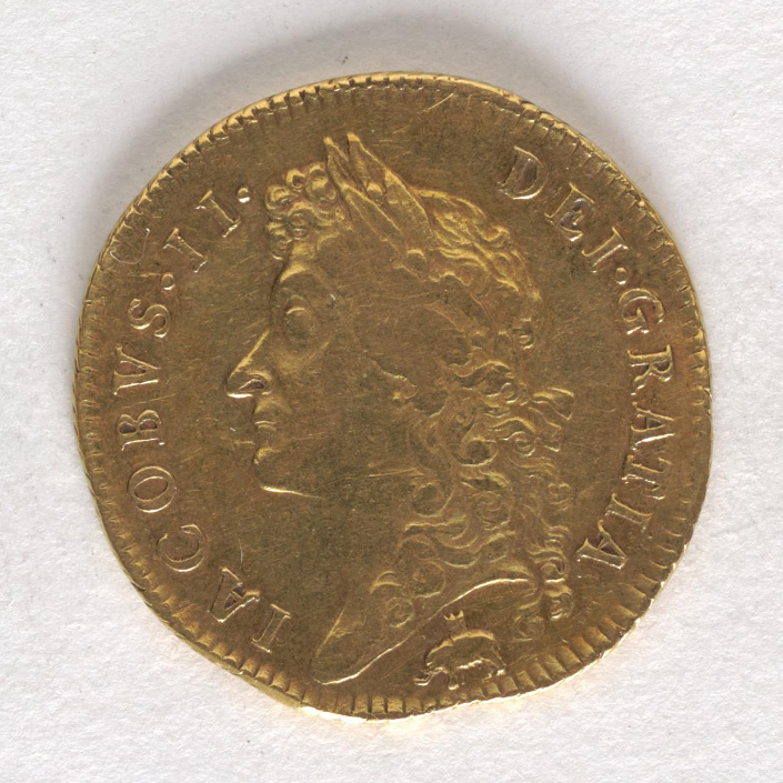 Coin, gold, a man's head facing left, and a tiny elephant carrying a castle on its back at the bottom.