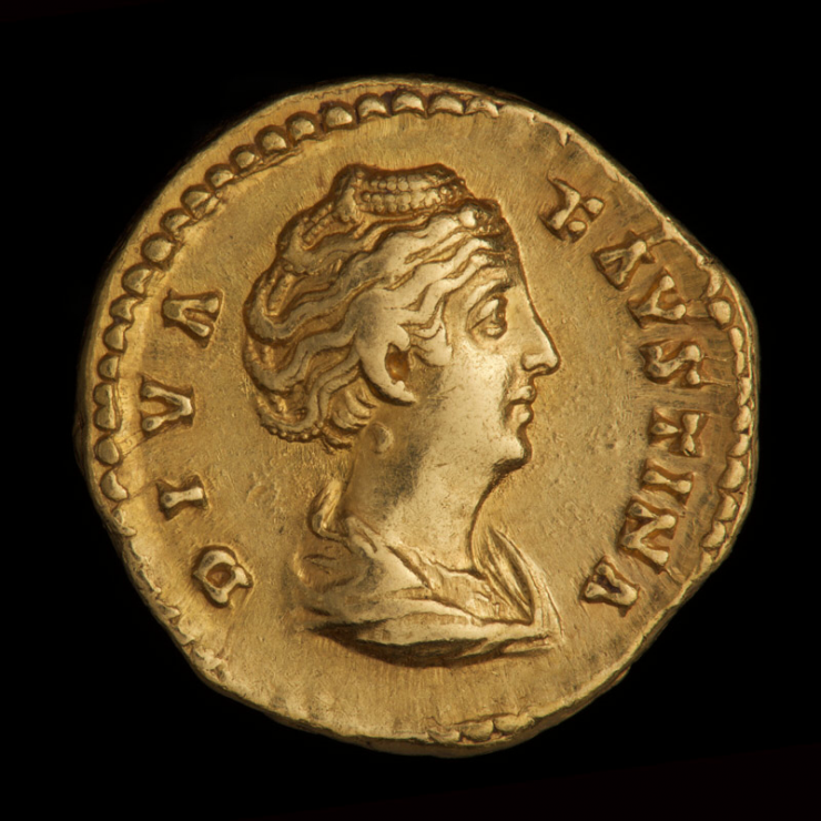 Coin, gold, a woman's portrait facing right and words along the edge.