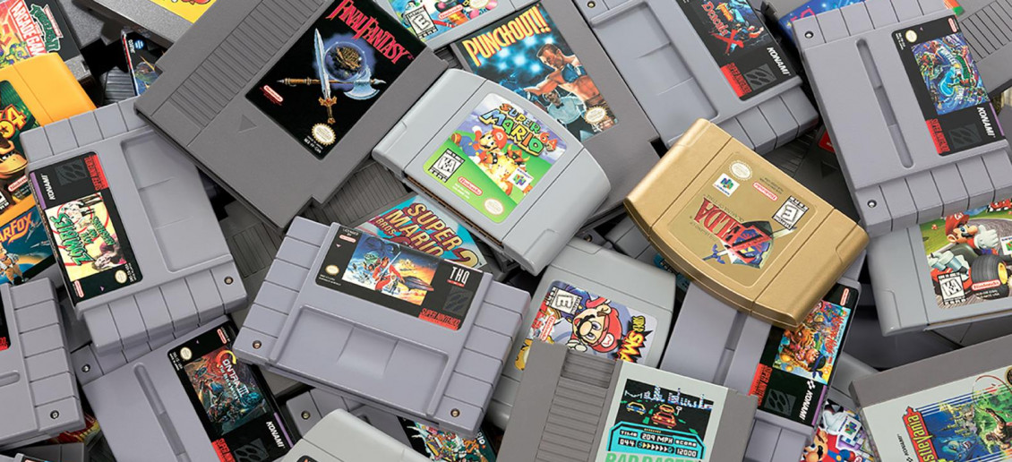 A collage pile of grey rectangular video game cartridges